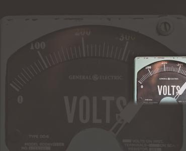 A voltage meter - with the pin indicating full power