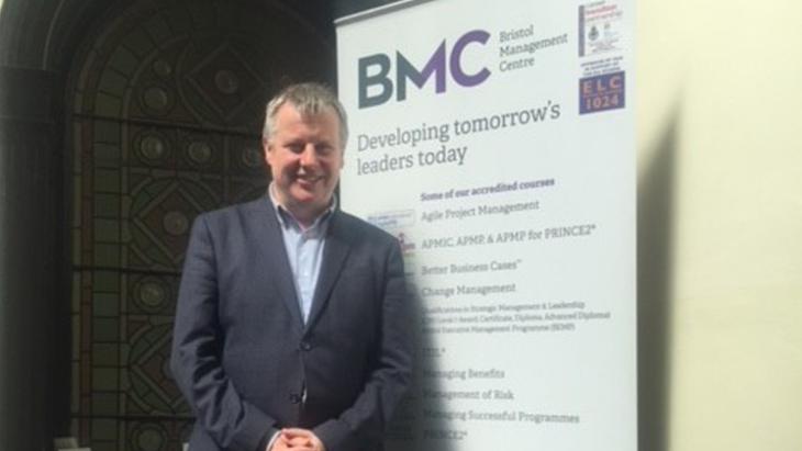 Gary McGaffney stood beside a BMC banner